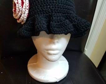 Crochet hat with rose