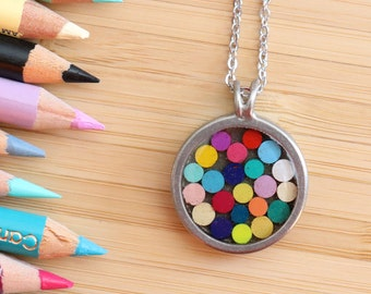 Minimalist round Tin pendant made with recycled into the resin colour pencils