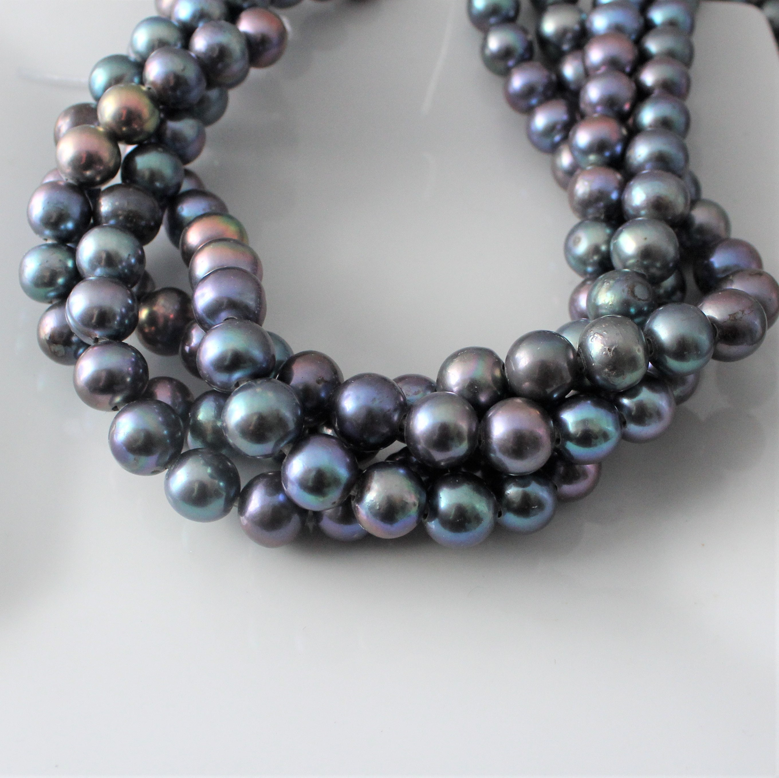 on peacock pin drop and triple leather slides knotted making closure pearl pearls an beautiful this necklace
