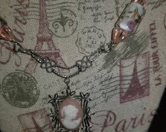 When Austen dreams, she dreams in pink cameo necklace.