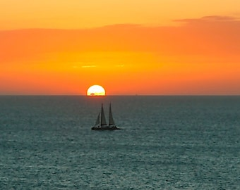 FIERY SUNSET, with  SAILBOAT on Steely Blue Sea.  Eastern Caribbean.  Blank Greeting Card. Fine Art Photography. Copyright Protected