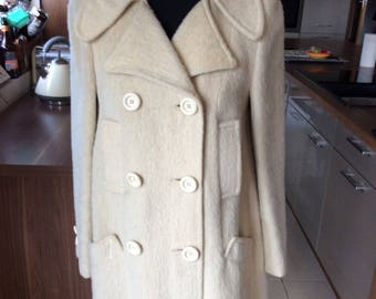 Vintage: 1960-70s cream swing style coat.