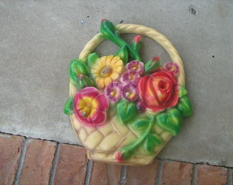 A 1960s vintage . chalkware hanging  basket with flowers