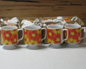 Set of 12 Vintage Pedestal Mugs White w/Orange, Red, Yellow design Unmarked