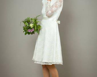 """Hochzeitskleid """"Laura"""" aus feiner Spitze mit mit Rückenausschnitt, in cremeweiss"""
