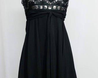 Dress with rhinestones on top