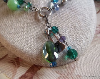 Versatile blue, green, teal and lilac beaded necklace made with crystals, glass, and pearl beads