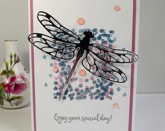 Dragonfly card with die cut dragonfly in silver foil card, pink embellishments, and silver heat embossed sentiment