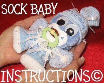 Instructions for a SOCK BABY. Learn how to make this adorable Baby Gift or Diaper Cake Topper.