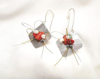 Handmade earrings made of brass in shape of a rhombus and coral pearls.