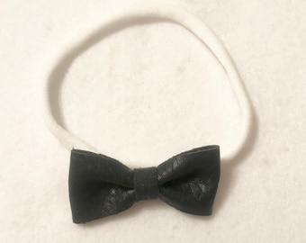 Mini black leather bow