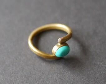 Gold tone costume ring with turquoise coloured stone UK size O