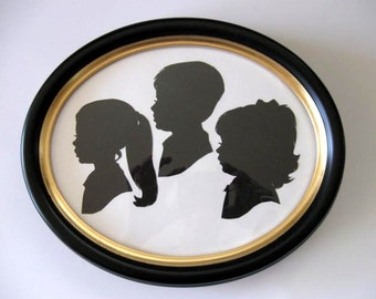 3  Hand Cut Silhouettes in an 8x10 Real Wood Oval Frame