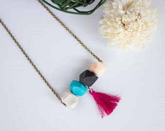 Necklace with geometric stones and tassels