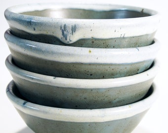 Stoneware blue-green rice or cereal bowls with white rims