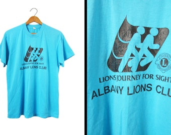 Vintage 80s Albany Lions Club T-shirt Turquoise Blue Screen Stars - Medium