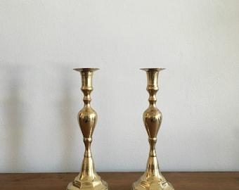 vintage hollywood regency boho brass candlesticks. mid century brass graduated candlesticks. candle holders interior design home decor