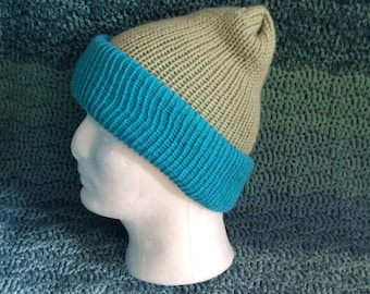 Double thickness knitted reversible hat also convertible into scarf