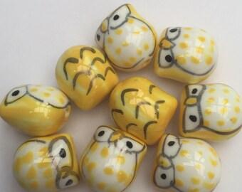 Set of 9 handmade porcelain yellow owl beads.