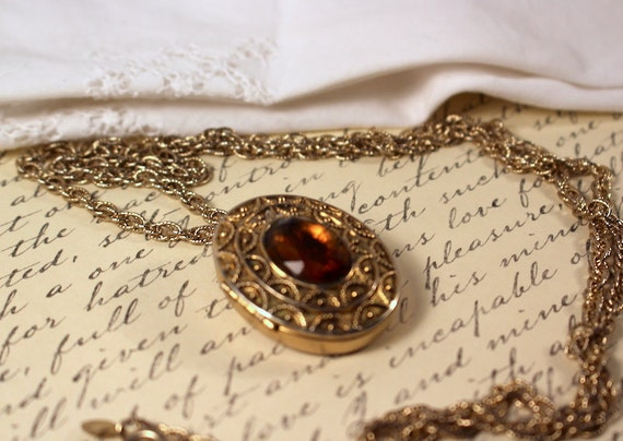 Avon perfume pendant necklace gold tone with topaz colored aloadofball Choice Image