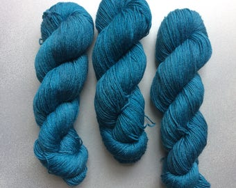 Hand dyed sock yarn, in Night Swimming 4ply finger weight superwash BFL and bamboo 100g. BFL is a British breed.