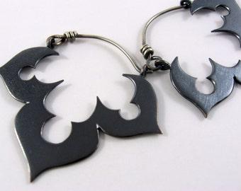 Genie's black lotus earrings in copper and sterling