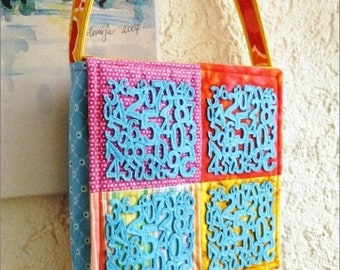 Shoulder bag in fabric and felt with numbers and flowers, handicraft, unique and exclusive specimen