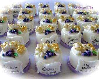Handmade cake made of corn paste. Original wedding favor for the first communion.