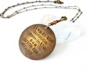 live in the sunshine swim in the sea drink the wild air handstamped necklace in brass with copper detail