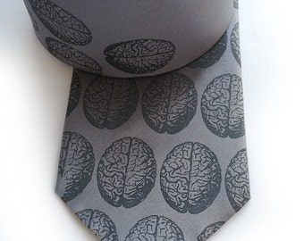 Brain dot men's silk tie. Silkscreened necktie, dove gray print. Perfect for zombie lovers. Your choice of color and width.