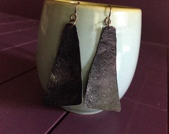 dark copper triangles