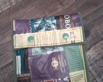 Clutch purse in packs of fair trade coffee
