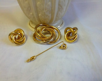 Beautiful Trio set of gold tone clip on earrings, lovely brooch and a lapel pin