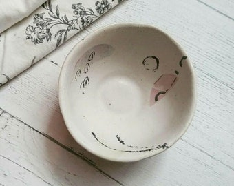 Ceramic ring dish with collage surface design