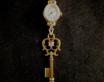 Gold Watch and Key Necklace