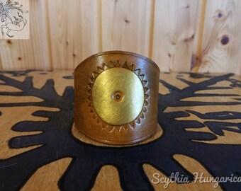 Genuine leather cuff bracelet with metallic gold Sun pattern