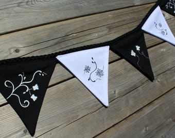 Garland of flowers and butterflies painted by hand, to decorate a party or a child's room, black and white flags