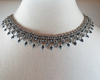 Silver collarbone lace necklace.