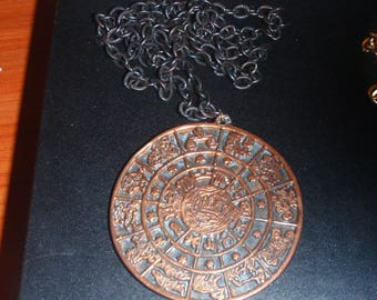 Marked 'ÁLBION 2517' egyptian revival large pendant and chain. vintage costume revival period jewelry aztec calender egypt