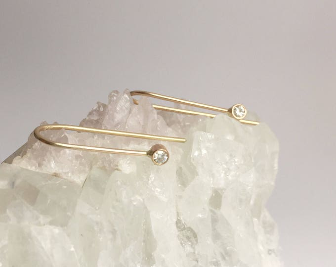 gold arc hoops with moissanites