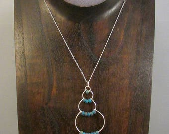 Silver wire bubble necklace with dark blue beads