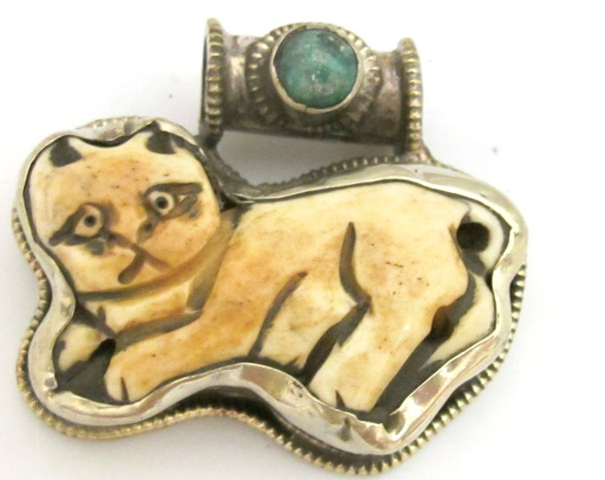 Tibetan silver carved bone Cat pendant with turquoise inlay and reverse side flower repousse - PM345D