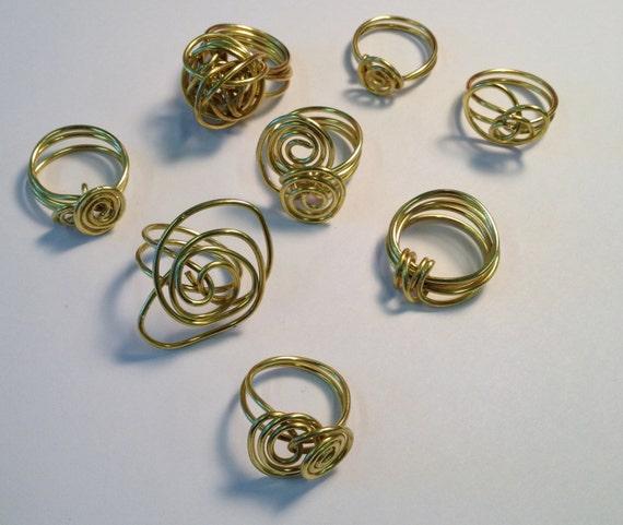 SJC10294 - Wire wrapped brass rings