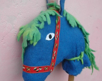 horse in carded wool to ride