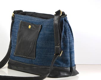 Blue repurposed upholstery and repurposed black leather, cross-body, hobo style handbag