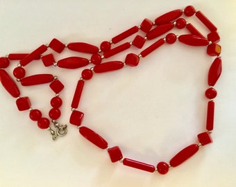 Lovely vibrant red lucite beaded single strand necklace.  30 inches long.  Perfect to pare with other necklaces.