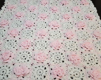 Pink flowers and white granny square baby blanket