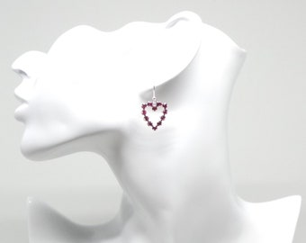 Heart pendant earrings featuring Swarovski crystal.