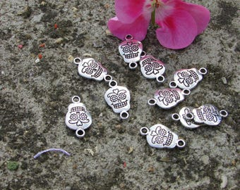 Long about 10 charms skull skulls solid Tibetan silver 15 mm approx