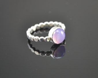 Flat dots band ring with purple chalcedony cabochon.